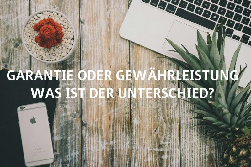 """Titelbild: Laptop und Smartphone auf Holztisch """"Garantie oder Gewährleistung - was ist der Unterschied?"""""""