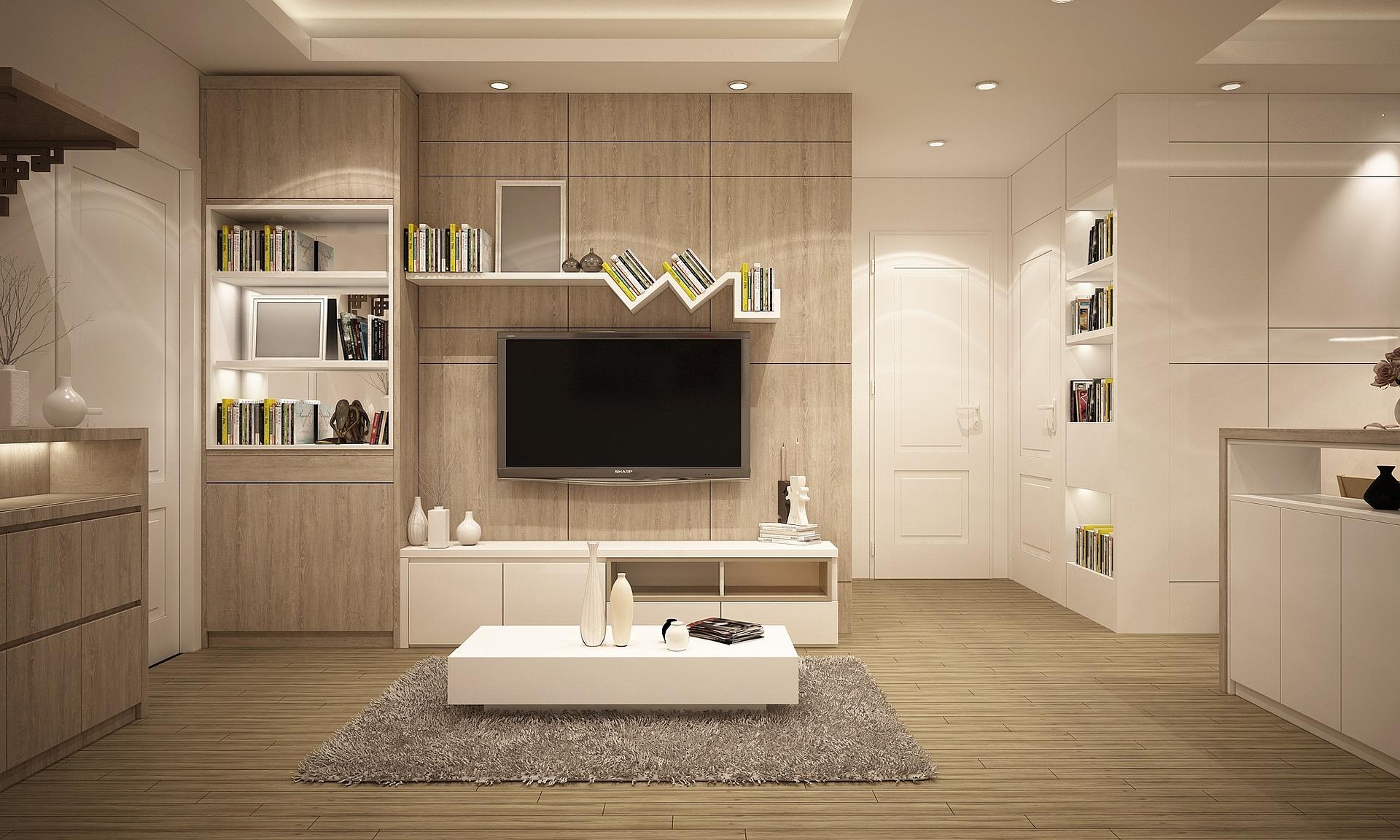 Haushaltsgeräte: Herstellergarantie vs. separate Elektronikversicherung:Wohnzimmer mit Fernseher im Mittelpunkt des Bildes.